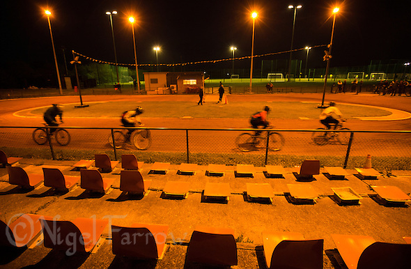 05 MAY 2015 - IPSWICH, GBR - Ipswich Eagles Cycle Speedway Club members race round the track during a club championship night at Whitton Sports and Community Centre in Ipswich, Suffolk, Great Britain (PHOTO COPYRIGHT © 2015 NIGEL FARROW, ALL RIGHTS RESERVED) (NIGEL FARROW/COPYRIGHT © 2015 NIGEL FARROW : www.nigelfarrow.com)