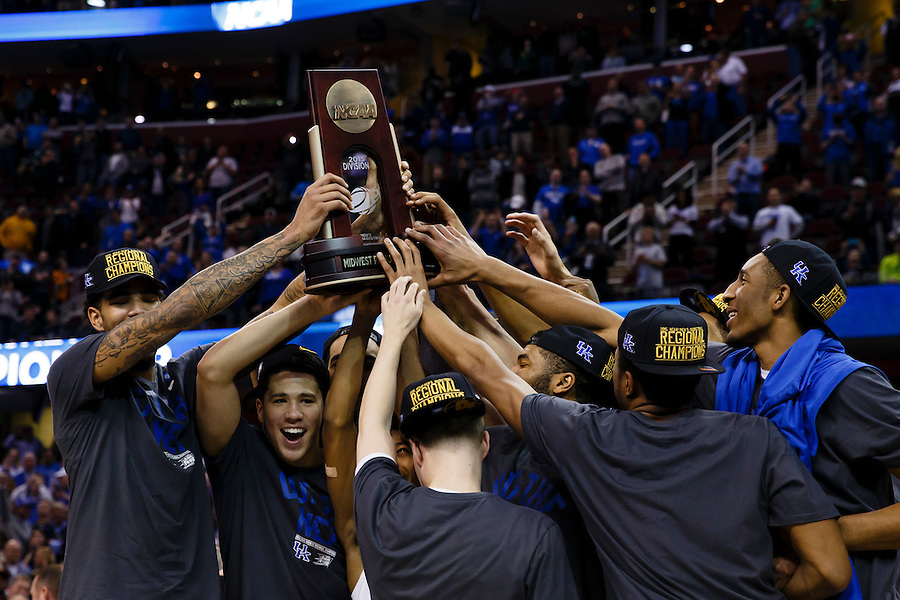Mar 28, 2015; Cleveland, OH, USA; Kentucky Wildcats players lift up the trophy after defeating Notre Dame Fighting Irish in the finals of the midwest regional of the 2015 NCAA Tournament at Quicken Loans Arena. Mandatory Credit: Rick Osentoski-USA TODAY Sports (Rick Osentoski/Rick Osentoski-USA TODAY Sports)