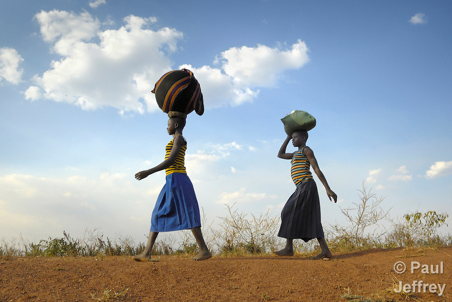 Women walking home near the Namokora camp for internally displaced persons. Two decades of war in northern Uganda have left almost two million people displaced, though progress in peace talks in 2006 initiated a small movement to return to home villages. (Paul Jeffrey)