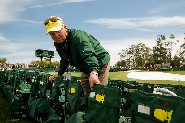 Gallery guard John Gibson, who has been assisting the patrons at the 18th green for 22 years, tries to make room for one more chair.Golf: 2016 Masters Round 4 Sunday Augusta National/Augusta, GA, USA 04/10/2016 SI-14 TK4 Credit: Darren Carroll (Darren Carroll/Sports Illustrated)