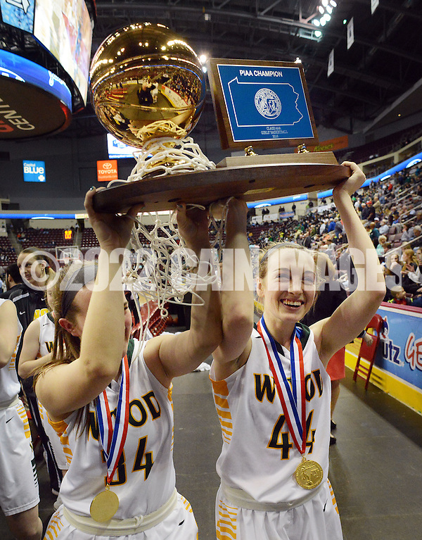 From left, Archbishop Wood's Meg Neher #34 and Claire Bassetti #44 carry the championship trophy off the court as they celebrate after defeating Villa Maria to win the girls basketball PIAA Class AAA state championship Saturday March 19, 2016 at the Giant Center in Hershey, Pennsylvania (Photo By William Thomas Cain) (William Thomas Cain/Cain Images)