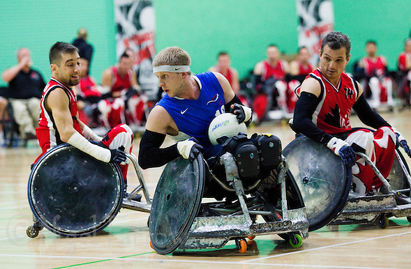 15 AUG 2011 - LEEDS, GBR - Great Britain's Aaron Phipps looks for a way past the Canadian defence during the wheelchair rugby exhibition match between Great Britain and Canada .(PHOTO (C) NIGEL FARROW) (NIGEL FARROW/(C) 2011 NIGEL FARROW)