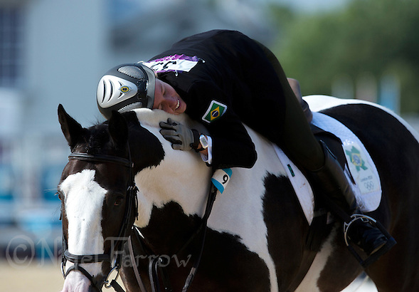 12 AUG 2012 - LONDON, GBR - Yane Marques (BRA) of Brazil hugs her horse Over the Odds after completing her round during the women's London 2012 Olympic Games Modern Pentathlon riding in Greenwich Park, Greenwich, London, Great Britain .(PHOTO (C) 2012 NIGEL FARROW) (NIGEL FARROW/(C) 2012 NIGEL FARROW)