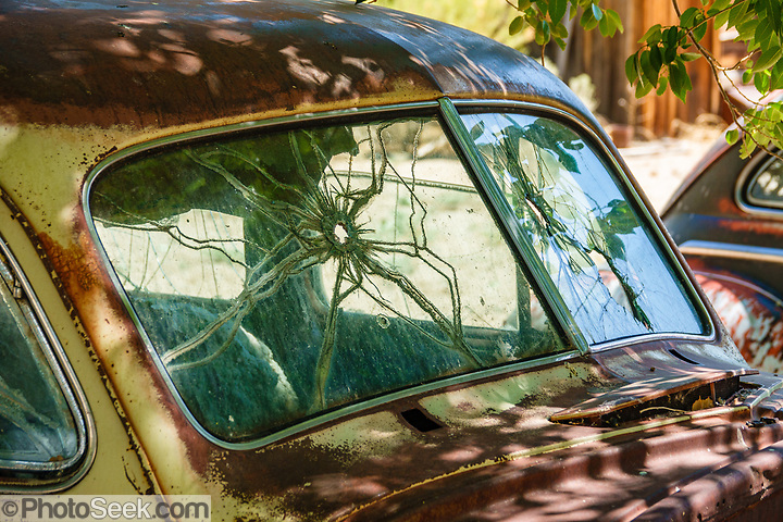 Cracked windshield on rusting car in Benton Hot Springs, Mono County, California, USA. (© Tom Dempsey / PhotoSeek.com)