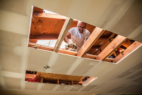 Tommy Guteirrez frames in holes in the ceiling and roof in preparation of installing skylights in our Calistoga home. (Clark James Mishler)