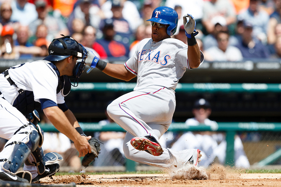 May 22, 2014; Detroit, MI, USA; Texas Rangers third baseman Adrian Beltre (29) slides in safe at home ahead of the tag by Detroit Tigers catcher Alex Avila (13) in the third inning at Comerica Park. Mandatory Credit: Rick Osentoski-USA TODAY Sports (Rick Osentoski/Rick Osentoski-USA TODAY Sports)