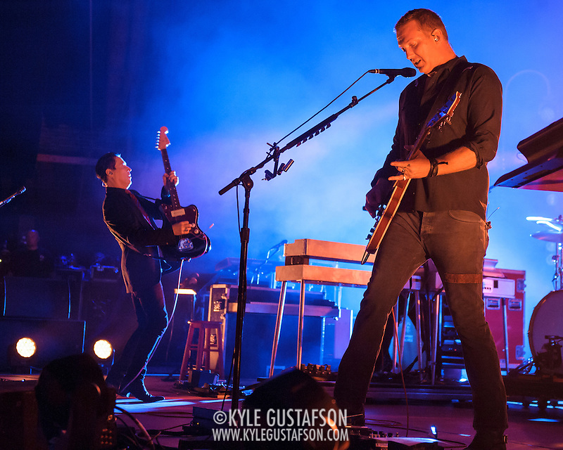 "COLUMBIA, MD - July 17th, 2014 - Troy Van Leeuwen and Josh Homme of Queens of the Stone Age perform at Merriweather Post Pavilion. The band's 2013 album, ""…Like Clockwork,"" was the group's first album to top the US Billboard 200 album charts. (Photo by Kyle Gustafson / For The Washington Post) (Kyle Gustafson/For The Washington Post)"