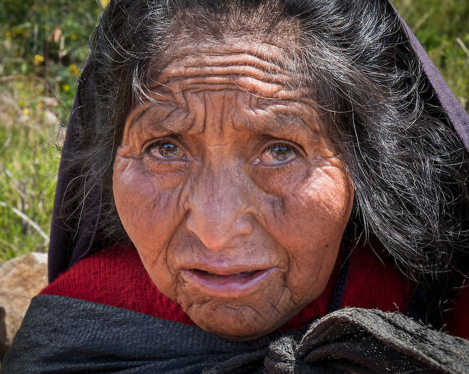 TAQUILE ISLAND, PERU - CIRCA APRIL 2014: Portrait of old woman from Taquile Island in Peru (Daniel Korzeniewski)