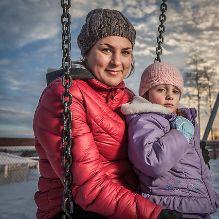 "Au pair, soon to be full time college student, Miriam Becker with Leona (4) and Jack (5) at Chugach Optional Elementary school playground, Anchorage.  ""I arrived from Germany two years ago but Anchorage is now home"".  miriambecker92@web.de (Clark James Mishler)"