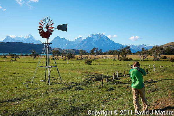 Photographer Working the Windmill at Lazo Estancia in Patagonia. Paine National Park, Lago Verde, Chile. Image taken with a Nikon D3x and 16-35 mm f/4 lens (ISO 100, 35 mm, f/11, 1/80 sec). (David J Mathre)