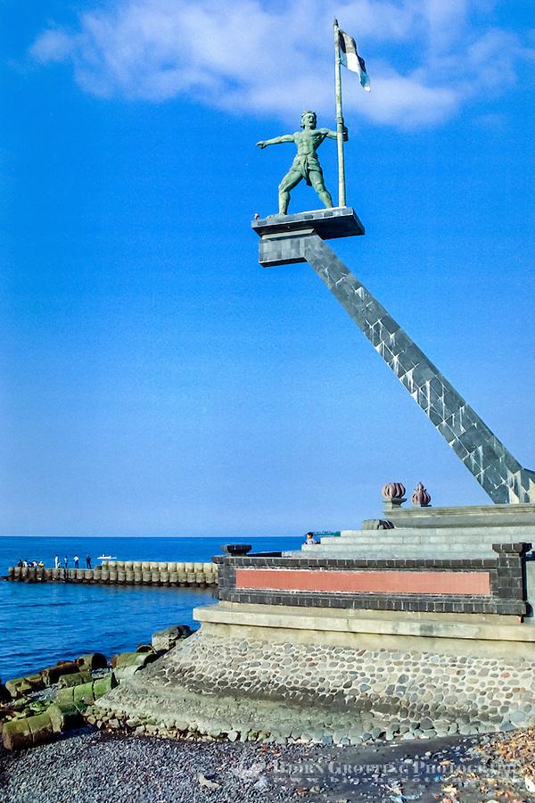 Bali, Buleleng, Singaraja. The statue of Ketut Merta with the Indonesian flag in Singaraja harbour. (Photo Bjorn Grotting)