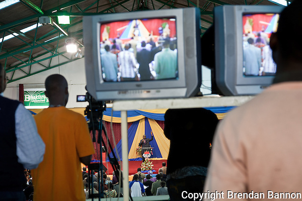 The overflow crowd watches a video feed of Pastor David Adeoye during Easter Sunday services at Nairobi's Winner's Chapel, a fast growing evangelical Christian Church, founded in Nigeria. (Photographer: Brendan Bannon)