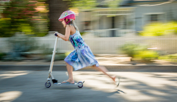On the final week of summer break, Mya Shuler speeds through the streets of Calistoga on her Razor push schooter. (Clark James Mishler)
