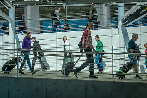 Arriving and departing travelers navigate passenger ramps at SeaTac International Airport. (Clark James Mishler)
