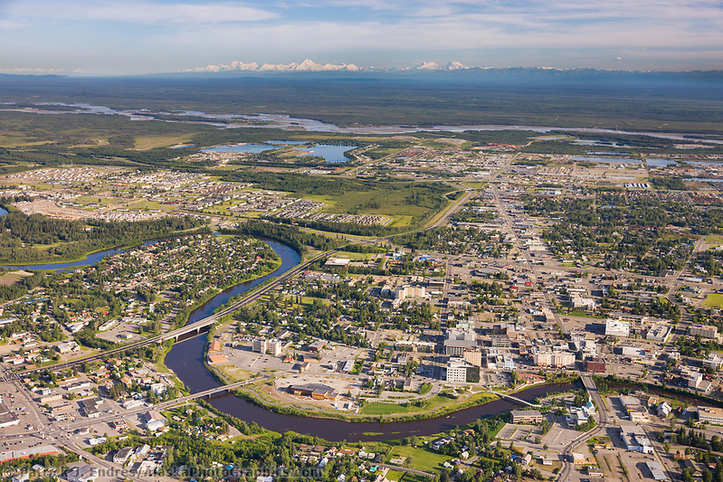 Aerial view of the Chena river winding through the city of Fairbanks and the Tanana river to the south of town, Alaska Range mountains on the distant horizon. (Patrick J. Endres / AlaskaPhotoGraphics.com)