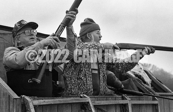 Ron Kobli, left, loads his gun as Herb Booth shoots at a goose Saturday November 2, 1991 in Buckingham, Pennsylvania. (Photo by William Thomas Cain) (William Thomas Cain/Cain Images)