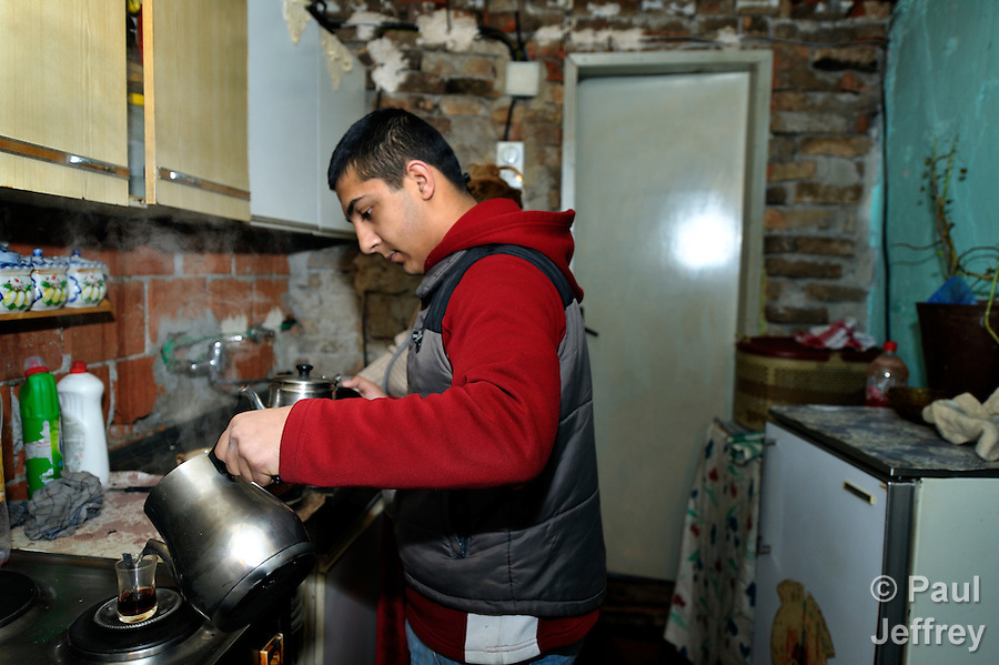 Bajram Kruezi pours himself coffee as he prepares to leave home in the morning in the Zemun Polje neighborhood of Belgrade, Serbia, on his way to the Branko Pesic School, an educational center for Roma children and families which is supported by Church World Service. Kruezi's family came to Belgrade as refugees from Kosovo, and like many Roma can't afford regular school fees. Many Roma also lack legal status in Serbia, and thus have difficulty obtaining formal employment and accessing government services. Kruezi wants to be a Muslim religious scholar when he grows up.