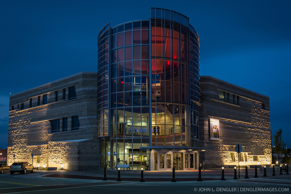 The $24.4 million Flint Hills Discovery Center, located in Manhattan, Kansas celebrates the history, culture, and heritage of the Flint Hills and tallgrass prairie. Through interactive exhibits Flint Hills Discovery Center visitors can explore the science and cultural history of the last stand of tallgrass prairie in North America - one of the world's most endangered ecosystems...The Flint Hills Discovery Center was designed by the museum architectural firm Vern Johnson Inc. with interpretive design and planning by Hilferty and Associates. The 34,900 square foot science and history learning center features permanent interactive exhibits, temporary exhibits, and areas for community programs and outreach activities...Attractions of the Flint Hills Discovery Center include: a 15-minute 'immersive experience' film which has special effects such as fog, mist and wind which appear in the theater as the high definition film is shown on a large panoramic screen; an 'underground forest' depicting the long roots of prairie plants including the 7-foot roots of bluestem prairie grass; explanations of importance of fire to the Flint Hills tallgrass prairie; and exhibits about the people and cultural history of the Flint Hills. (John L. Dengler)