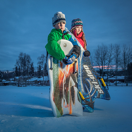 Friends Chelsea (11) and Hawke (7) at the sledding hill at Inlet view school, Anchorage. (Clark James Mishler)