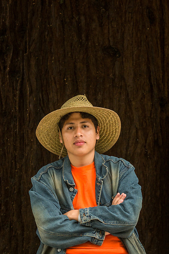 """""""My aunt started the US residency process for me in Mexico fourteen years ago. I've been here two months and I am totally legal!"""" -Nineteen year old Marvin Mendez pauses on Berry Street while walking home in Calistoga. (Clark James Mishler)"""