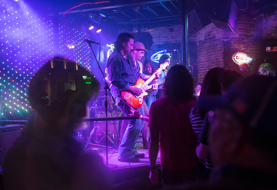 NEW ORLEANS - CIRCA FEBRUARY 2014: Music group performing in a nightclub during the Mardi Gras celebration in the French Quarter in New Orleans (Daniel Korzeniewski)