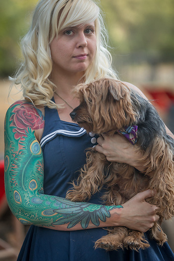 Katie Helldorfer attends a wedding with her dog, Kaiser, at Starry Skies Ranch in Healdsburg, CA (Clark James Mishler)