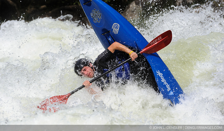An unidentified whitewater kayaker overturns their kayak going through the rapids at Pillow Rock on the Gauley River during American Whitewater's Gauley Fest weekend. The upper Gauley, located in the Gauley River National Recreation Area is considered one of premier whitewater rivers in the country. (John L. Dengler)