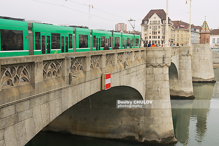BASEL, SWITZERLAND - MARCH 01, 2009: Tram passes by the bridge over Rhine river in Basel, Switzerland. (Dmitry Chulov)