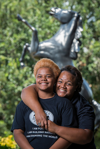 Tamokia Thompson, right, poses for a photograph with her daughter, Cienna Alley, left, at Fondren Middle School, September 9, 2014. (Houston ISD/Dave Einsel)
