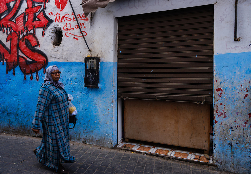 CASABLANCA, MOROCCO - CIRCA APRIL 2017: Muslim woman walking on an alleyway of the Medina in  Casablanca (Daniel Korzeniewski)