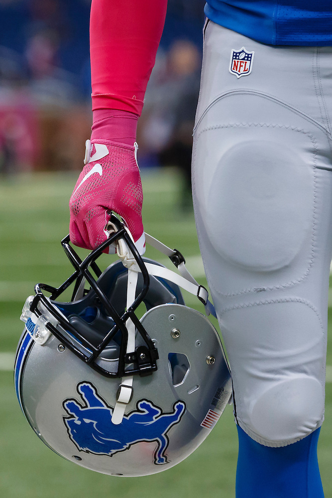 Detroit Lions wide receiver Golden Tate (15) wears pink gloves during warm ups prior to an NFL football game against the Arizona Cardinals at Ford Field in Detroit, Sunday, Oct. 11, 2015. (AP Photo/Rick Osentoski) (Rick Osentoski/AP)