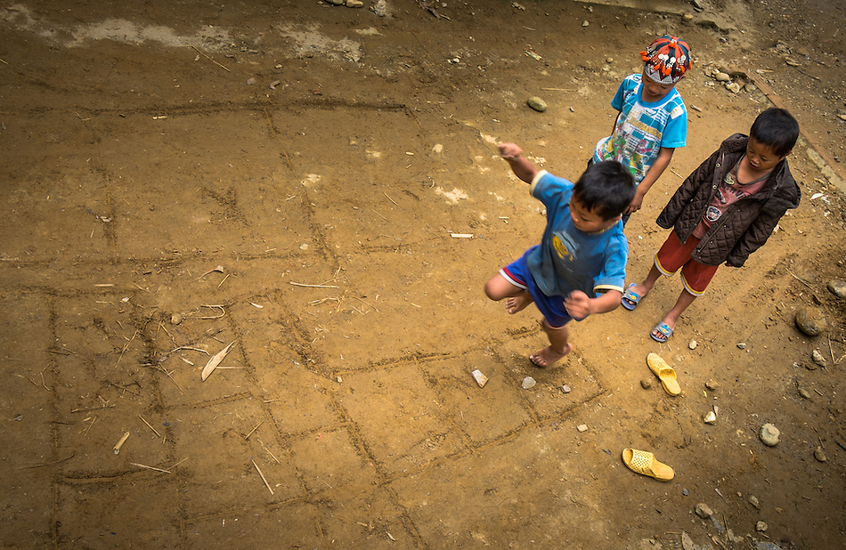 SAPA, VIETNAM - CIRCA SEPTEMBER 2014:  Kids playing hopscotch in Ta Phin Village near Sapa, north Vietnam. (Daniel Korzeniewski)