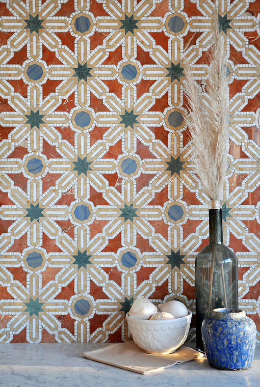 Alcazar, a natural stone waterjet and hand cut mosaic shown in Spring Green, Blue Macauba, Rojo Alicante and Renaissance Bronze polished, is part of the Miraflores Collection by Paul Schatz for New Ravenna Mosaics. (Picasa)