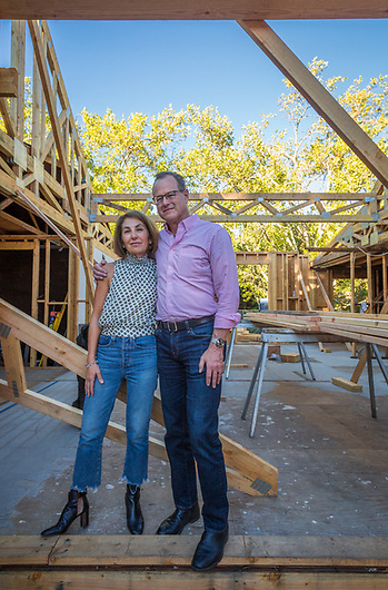 "Terry Goldin and Peter Kay stand inside their remodel project on Cedar Street in Calistoga. ""I must admitt that, until they put a roof on, I'm more than a little bit nervous."" -Peter Kay ""(During the Fires) we evacuated to my parent's place in Reno...we were afraid we might return to a pile of burned skicks."" -Terry Goldin. (Clark James Mishler)"