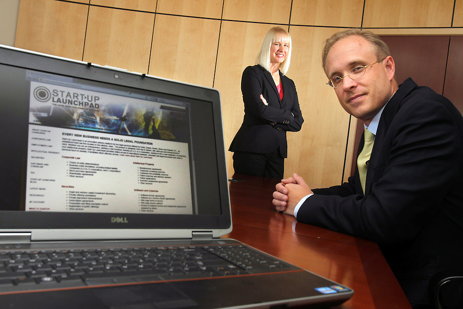 Jason Stone, right, and Emily Harris designed Davis Brown Law Firm's Start-Up Launchpad, a website that offers legal documents for flat fees, and is meant to be a specific resource for startup businesses. (Christopher Gannon/The Register)