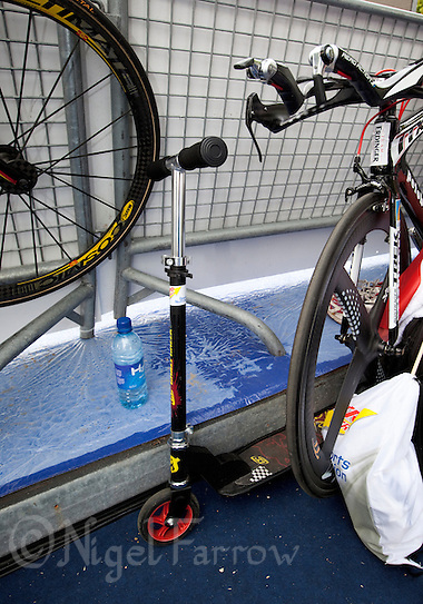 05 AUG 2011 - LONDON, GBR - A scooter stands amongst race bikes during the ITU World Championship Series pre race warm up .(PHOTO (C) NIGEL FARROW) (NIGEL FARROW/(C) 2011 NIGEL FARROW)