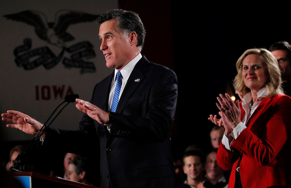 MITT ROMNEY, with wife ANN, right, delivers a speech following the Iowa caucus Tuesday, January 3, 2012 in Des Moines, Iowa. (Christopher Gannon/ZUMA Press)