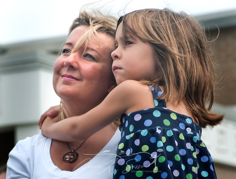 "Tonya Schevers holds her daughter, Marlee Schevers, 7, during a ceremony commemorating the fifth anniversary of Hurricane Katrina Aug. 29, 2010 in Gulfport, Miss. ""We have a long way to go, but we've come a long way in a short time,"" Schevers said. Approximately 231 people died in Mississippi during Katrina, and some infrastructure is still in ruins. (Photo by Carmen K. Sisson/Cloudybright) (Carmen K. Sisson/Cloudybright)"