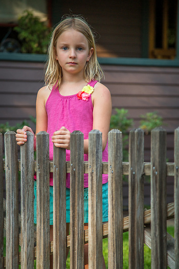My neighbor and always willing photographic subject, Ella Fitzpatrick, stands in front of her friend's house in Calistoga. (Clark James Mishler)