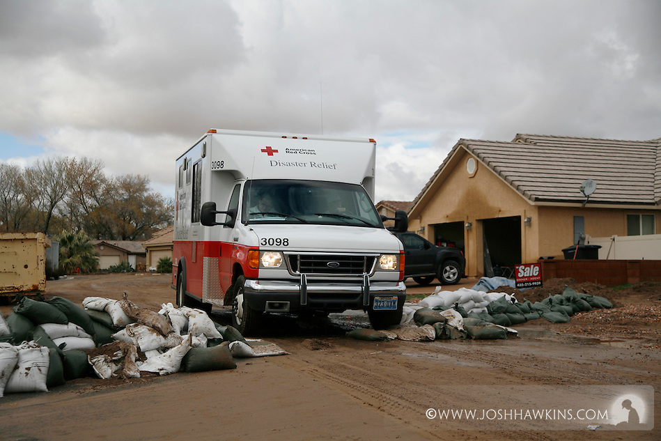 Red Cross disaster assessment teams in Beaver Dam, AZ on December 23rd, 2010 after the flooding the occurred over the previous days...The Emergency Response Vehicle goes over a former sandbag barricade on Beaver Dam Dr. while do disaster assessment. (Josh Hawkins)