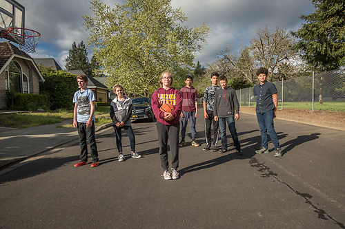 PUCE seventh and eighth grade students Londyn, Ashtyn, Lia, Michael, Trevor, Tyler and Ben pause from thier pick-up basketball game on Centennial Circle in Calistoga. (Clark James Mishler)