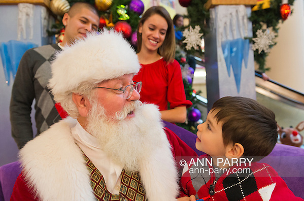 Nov. 21, 2012 - Garden City, New York, U.S. - Santa Claus gets a visit from PATRICK HERR, 3 1/2, from Hempstead, at Roosevelt Field shopping mall in Long Island. Parents JULIANA CARREON and ISMAEL CARREON took him to visit the jolly man at Roosevelt Field, one of the 10 largest shopping malls in the United States of America, and on the site where aviator Charles Lindbergh began his historic solo transatlantic flight to Paris in 1927. (Ann Parry/Ann Parry, ann-parry.com)