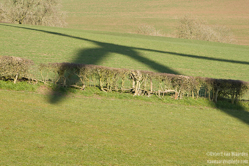 The shadow of the St. Briavels wind turbine on the green pastures of St. Briavels. (Robert van Waarden)
