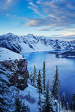 A view of Crater Lake in the wintertime with freshly fallen snow around the caldera rim. (Seth K Hughes)