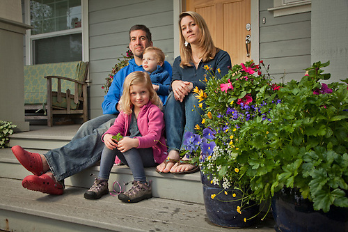 Neighbors, Chris and Ellen Chirichella and children on their porch, South Addition, Anchorage. (Clark James Mishler)