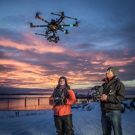 Hailey Driver of Sky Picture Films operates a remote camera suspended below a remote control helicopter controled by Thomas Mace at the small boat launch near Ship Creek, Anchorage        h.driver907@gmail.com (Clark James Mishler)