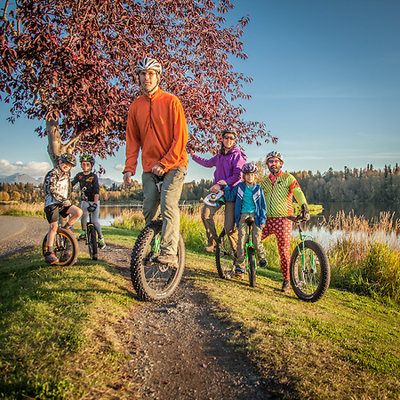 Unicyclist Richard Ragle with members of the Anchorage Unicycle Club: Aven (9), Max (7), Ruthie (9), Katie Peck and Ben Richardson at Westchester Lagoon, Anchorage (© Clark James Mishler)