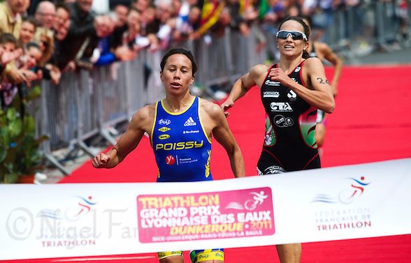 22 MAY 2011 - DUNKERQUE, FRA - Andrea Hewitt (Poissy Triathlon) (left) beats Emma Moffatt (Charleville Triathlon Ardennes) (right) and Barbara Riveros (Tri Val de Gray) (back) to the finish line at the women&#039;s round of the 2011 French Grand Prix triathlon series .(PHOTO (C) NIGEL FARROW) (NIGEL FARROW/(C) 2011 NIGEL FARROW)