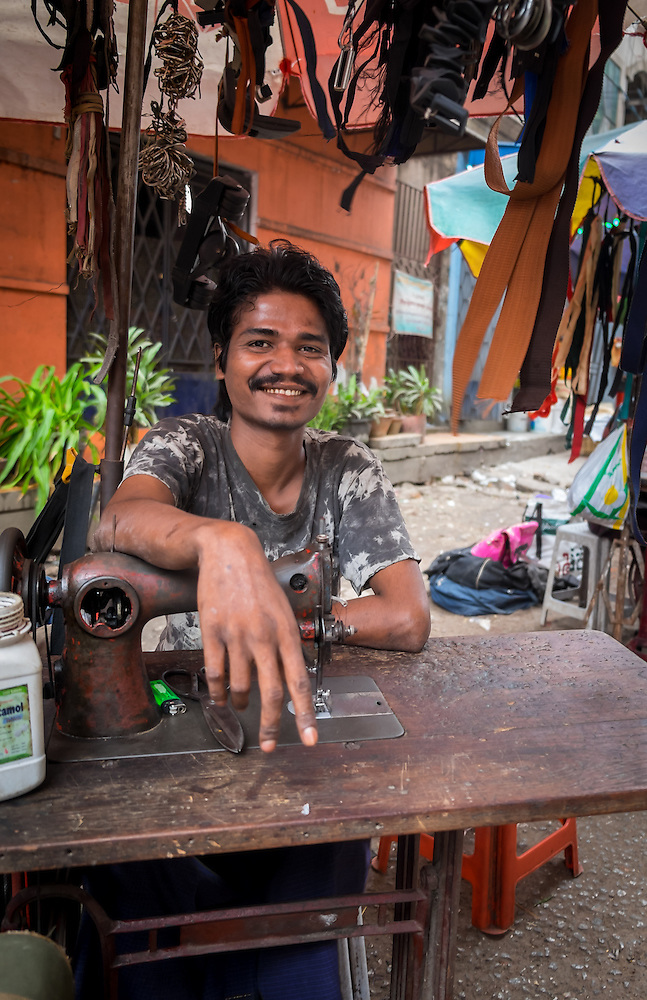 YANGON, MYANMAR - CIRCA DECEMBER 2013: Tailor offering alterations in the street market of Yangon (Daniel Korzeniewski)
