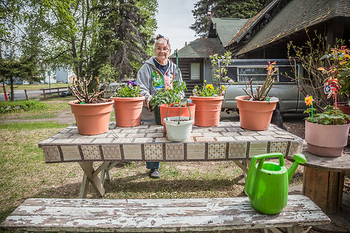 "South Addition Neighbor Irene Spykhoven prepares her plants for summer.  ""I have lived in this house since 1969...this is my favorite season."" (© Clark James Mishler)"